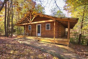log cabin with wraparound porch