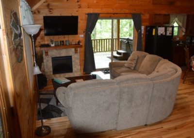 entertainment area in Escape log cabin