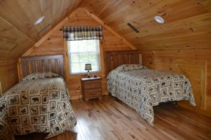 bedroom with twin beds in Escape log cabin