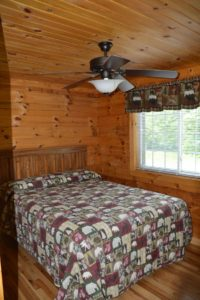 bedroom of Escape log cabin rental