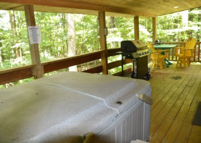 deck of The Landing log cabin with hot tub