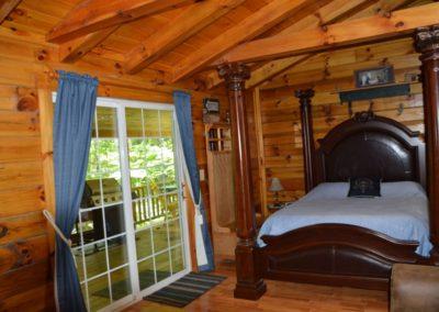 bedroom in The Landing log cabin