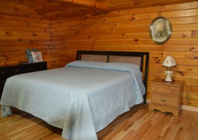 bedroom in The Overlook log cabin