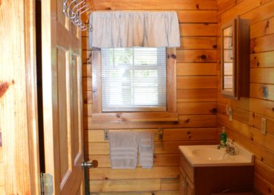 bathroom in The Overlook log cabin