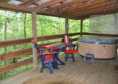 deck with hot tub at Nature's Paradise log cabin
