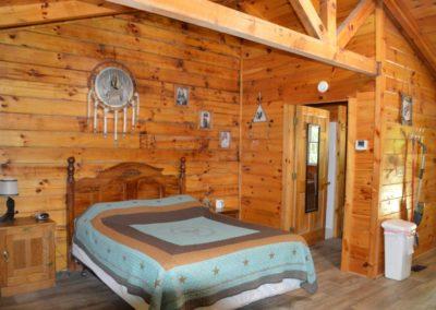 bedroom in The Lakota log cabin in Hocking Hills