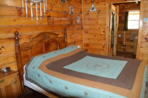 bedroom in The Lakota log cabin