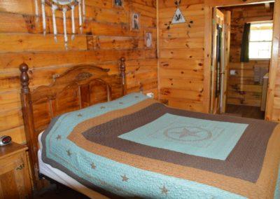bedroom in The Lakota log cabin