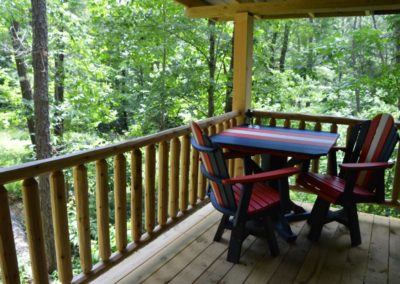 patio table and chairs on deck of Trail Ridge cabin