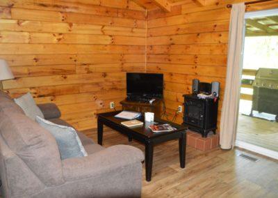 sofa and TV in Trail Ridge cabin