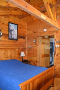 bedroom in Silverwolf log cabin rental