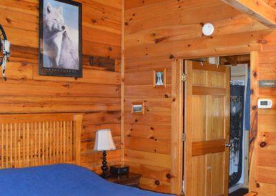 bedroom in Silverwolf log cabin rental