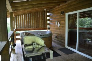 deck with hot tub and gas grill