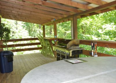 deck with hot tub at Yesteryear log cabin