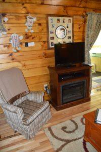 TV area in Yesteryear log cabin