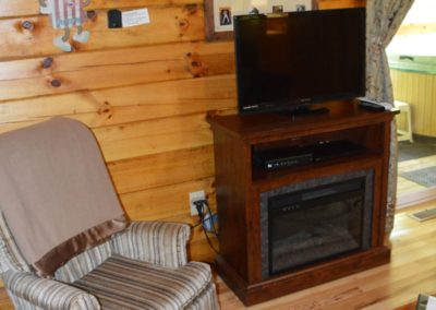 TV area in Yesteryear log cabin