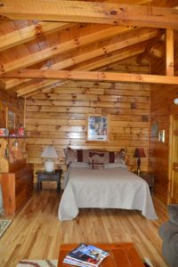bedroom in Yesteryear log cabin